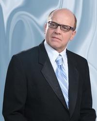 Dr. Adalbert Bader